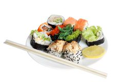 Sushi rolls. On plate isolated on the white background Stock Photos