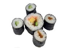 Sushi rolls. Containing cucumber specific Japanese vegetables and egg covered by sea-plant-specific Japanese name:maki rolls Royalty Free Stock Photos