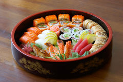 Sushi and rolls. Sushi and rolls on the tray on the table Royalty Free Stock Photos