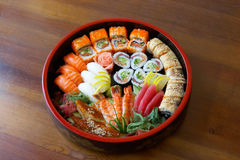 Sushi and rolls. Sushi and rolls on the tray on the table Royalty Free Stock Images