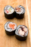 Sushi rolls. Four different sushi rolls on cutting board Stock Photography
