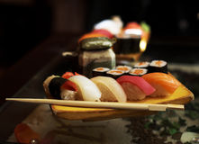 Sushi and  rolls. On the wooden plate Stock Images