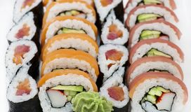 Sushi rolls assortment on white background royalty free stock photography