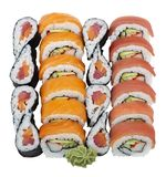 Sushi rolls assortment on white background. Sushi rolls with salmon and tuna isolated on white background royalty free stock images