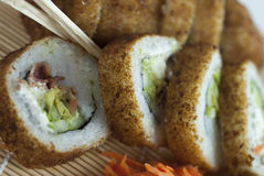 Sushi rolls. Bacon and meat sushi roll slices close-up Stock Photography