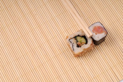 Sushi and rolls on bamboo Royalty Free Stock Images