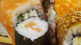 Sushi Rolls on a Bamboo Mat Rotates stock video footage