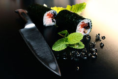 Sushi rolls on a black table Royalty Free Stock Photo