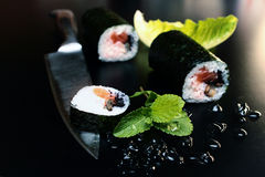 Sushi rolls on a black table Royalty Free Stock Photos