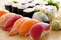 Sushi with Rolls on a Board Royalty Free Stock Photography