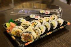 Sushi rolls in box Stock Photos