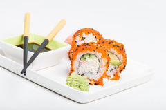Sushi rolls with caviar on the plate Royalty Free Stock Photography