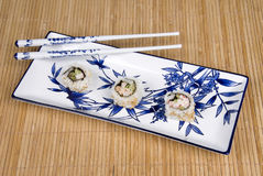 Sushi rolls on ceramic dishware Stock Photos