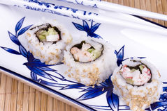 Sushi rolls on ceramic dishware Royalty Free Stock Images