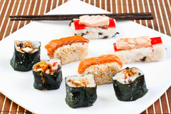 Sushi rolls and chipsticks Stock Photos