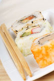 Sushi rolls and chopsticks Royalty Free Stock Photography