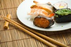 Sushi rolls and chopsticks Stock Photo