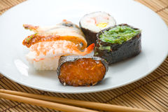 Sushi rolls and chopsticks Royalty Free Stock Photo