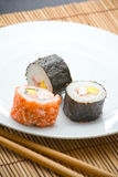 Sushi rolls and chopsticks Stock Images