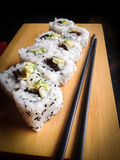 Sushi rolls with chopsticks royalty free stock photo