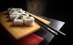 Sushi rolls with chopsticks royalty free stock photos