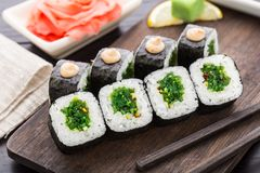 Sushi rolls with chuka salad Royalty Free Stock Image