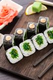 Sushi rolls with chuka salad Royalty Free Stock Images