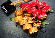 Free Sushi Rolls Closeup. Japanese Food In Restaurant. Roll With Salmon, Eel, Vegetables And Flying Fish Caviar Royalty Free Stock Photo - 117296175