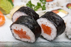 Sushi rolls closeup, rice and salmon. Typical japanese sushi rolls closeup Stock Images