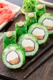 Sushi rolls covered with chuka Royalty Free Stock Photography