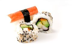 Sushi: Rolls and Crab. Two California Rolls and crab sushi isolated against a white background Stock Photography