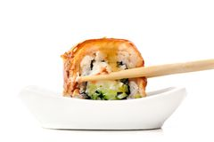 Sushi rolls with cream cheese, nori and cucumber covered with ee Royalty Free Stock Images