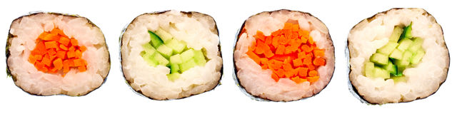 Sushi rolls with cucumbers and carrots in rice Stock Photo