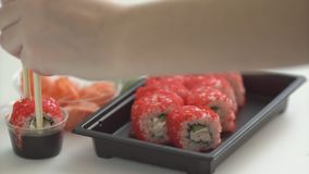 Sushi and rolls. Delicious seafood dinner. Japanese style serving. Selective focus stock video footage