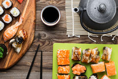 Sushi rolls with different fish and avocado, set of delicacies Stock Photos