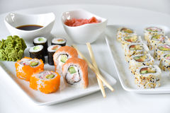 Sushi rolls dinner setting. Assortment of traditional japanese sushi, dinner setting Royalty Free Stock Photos