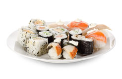 Sushi and rolls in a dishes Stock Photos