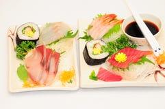 Sushi Rolls en el fondo blanco Foto de archivo libre de regalías