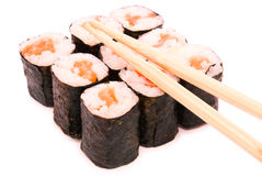 Sushi rolls in group with chopsticks, isolated on white backgrou Royalty Free Stock Photos