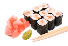 Sushi rolls in group with chopsticks Royalty Free Stock Images