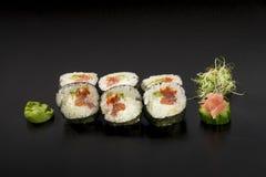 Sushi rolls hosomaki decorated with. Seaweed salad and wasabi Stock Photos