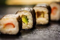 Sushi rolls hosomaki. Traditional japanese sushi rolls hosomaki on stone desk Stock Photo