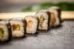 Sushi rolls hosomaki. Traditional japanese sushi rolls hosomaki on stone desk Royalty Free Stock Image