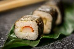 Sushi rolls hosomaki. Traditional japanese sushi rolls hosomaki on stone desk Stock Photos