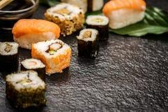 Sushi rolls hosomaki and uramaki. Traditional japanese sushi rolls hosomaki,uramaki, nigiri   on stone desk Stock Photos