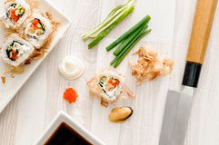 Sushi rolls with ingredients Royalty Free Stock Images