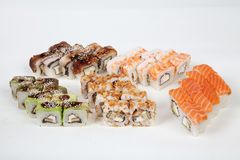 Sushi rolls Japanese food restaurant fish figure on a white background. 1 royalty free stock photos