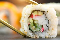 Sushi rolls. Japanese food in restaurant. Sushi roll set california with salmon Stock Photo