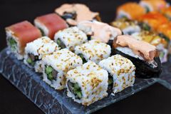 Sushi rolls - Japanese food. Sushi, rolls, Japanese food on glassware a dark background. Food for gourmets Royalty Free Stock Image