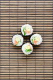 Sushi rolls lies on a bamboo straw serwing mat. Traditional Asian food. Top view. Flat lay minimalism shot with copy space.  stock photos
